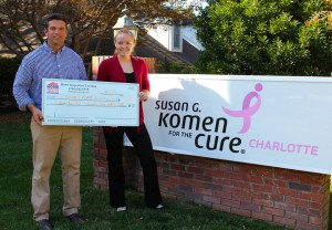 Charlotte home Inspector Giving Check to Susan G Komen